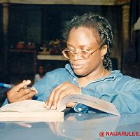 Ace director of Soap operas and video movies, Amaka Igwe, writing a cheque.