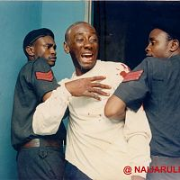 "Charles Ifediba as ""KK"" being dragged off by cops."