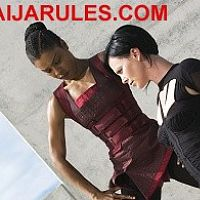 Sophie Okonedo with Charlize Theron in Aeon Flux