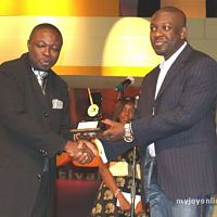 Kojo Oppong Nkrumah presenting an award at the ceremony