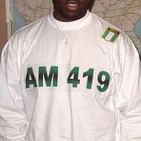 ...this pic was snapped couple years ago..my pal Modizel just dug it out and email am to me...kai!!The shirt was to represent the AM-419 UNDA-G Musical Movement started by Yours Truly, Pa J and Damask a.k.a Modizel..and was designed and given as a gift by some Afrocentric Akata Artist who enjoyed wetin we dey do when we first came out. The Movement will be coming out with it's third CD(This time to incorporate both Yanki and Naija-based Artists) possibly sometime later this year:)